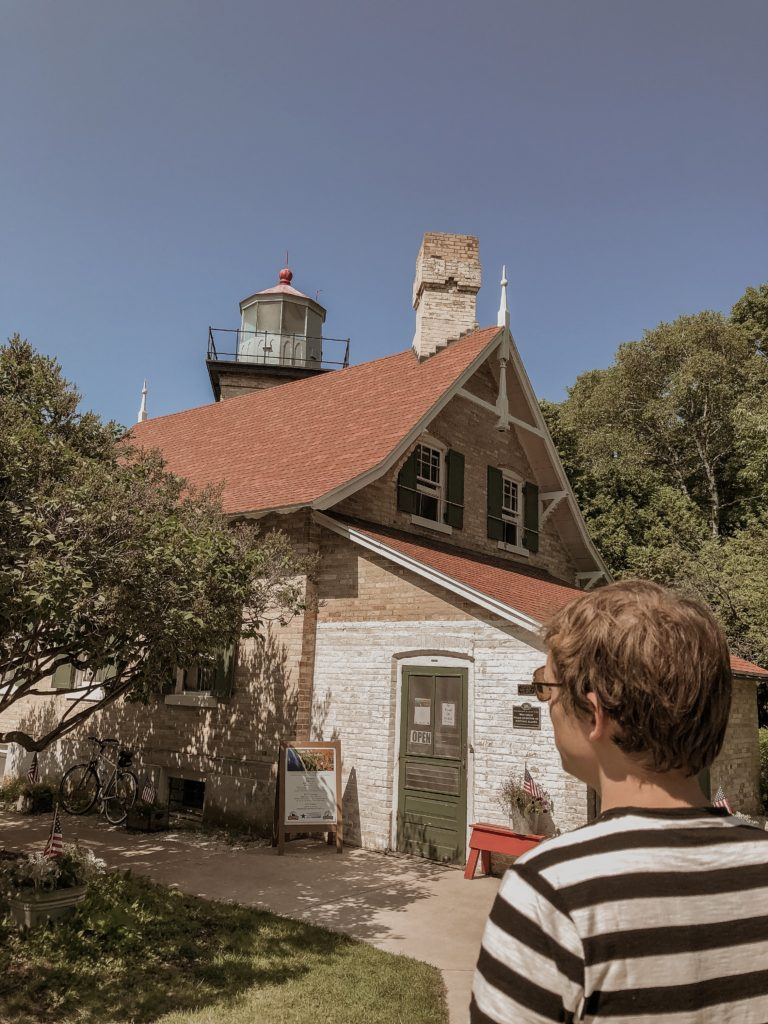 lighthouse in peninsula state park in door county, everlane men's t-shirt, everlane black and white striped t-shirt