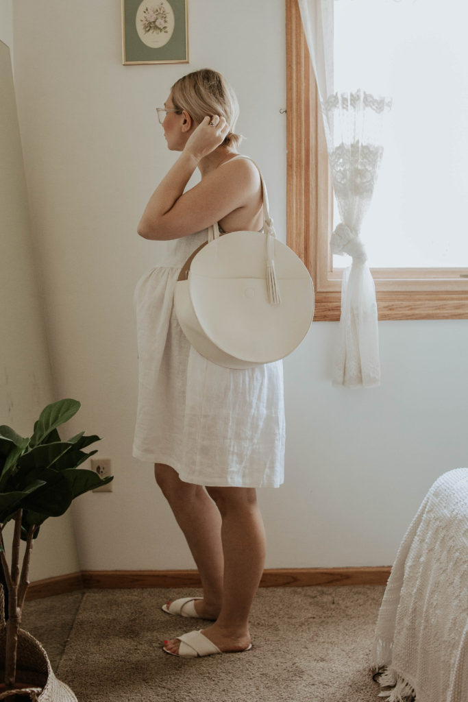 white linen dress, white sandals, white circle bag, linen maternity dress