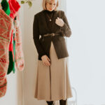 Mini Holiday Lookbook Featuring Ethical Fashion, black turtleneck sweater, brass blazer, black blazer, belted blazer, taupe silk skirt, bias cut silk skirt, black knee high boots, everlane knee high boots